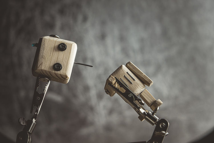 Close-up of coin-operated binoculars on wood