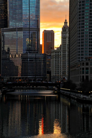Chicago during a colorful winter sunset, which is reflected in the Chicago River. Waysofseeing Chicago Chicago River Chicago Loop Cityscape Downtown Chicago Michigan Avenue Reflection Skyline Trump Tower Winter Architecture Building Exterior Buildings Built Structure Cityscape Colorful River Riverwalk Sky Skyline Skyscraper Sunset Tall - High Urban Skyline Water