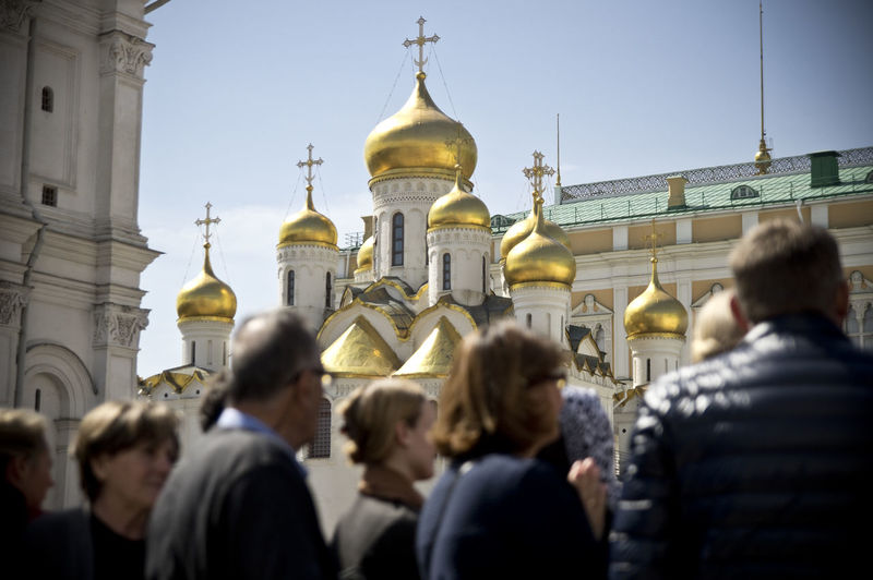 Check This Out Kremlin Moscow Russia Travel Photography Adult Architecture Building Exterior Built Structure Day Dome Focus On Background Gold Colored History Large Group Of People Lifestyles Outdoors People Place Of Worship Real People Rear View Religion Sky Spirituality Travel Destinations