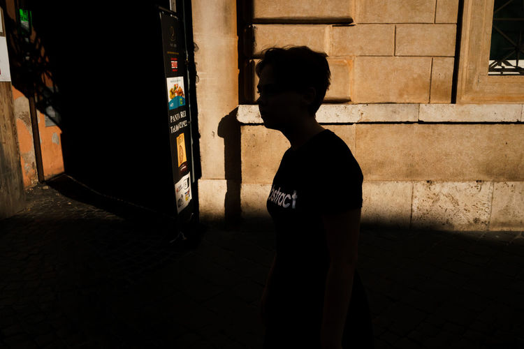 Light And Shadow Real People One Person City Lifestyles Street Silhouette Standing Leisure Activity Abstract City Street Streetphotography Girl Walking Streetwise Photography