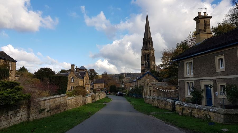 The beautiful Edensor village... Church For Anyone Whos Interested Beauty In Nature Beautiful Nature Having Fun Beautiful Beautiful Building  Derbyshire Check This Out Peak District  Blue Sky Because 🌟i🌟can😛 Village Life Edensor City Tree Sky Architecture Building Exterior Built Structure Cloud - Sky Village Cottage Idyllic