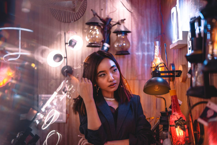 Portrait of woman with illuminated lighting equipment