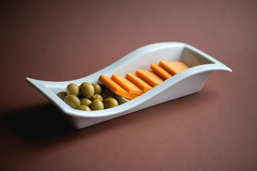 Brown Background Cheddar Cheese Close-up Day Food Food And Drink Freshness Green Olives Healthy Eating Indoors  No People Plate Ready-to-eat Still Life Studio Shot White