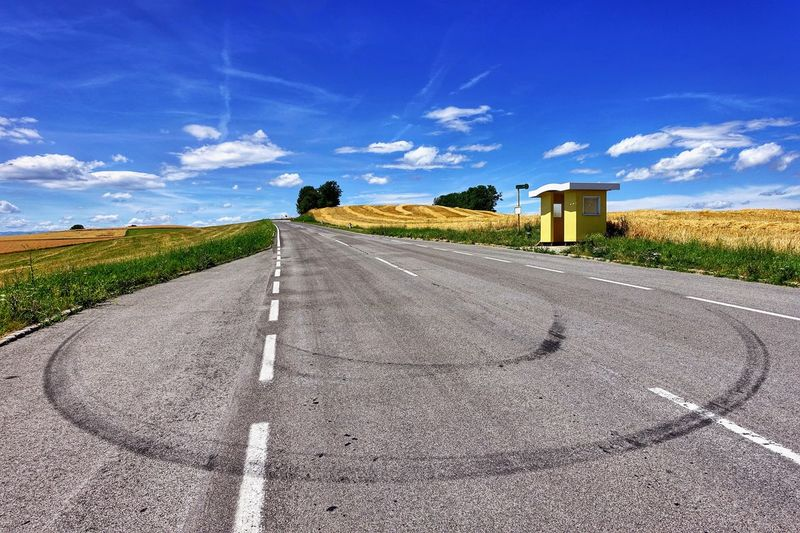 Hello friends, I am back! 😉 Road Road Marking The Way Forward Asphalt Transportation Sky Cloud - Sky Landscape Daily Inspiration Capture The Moment Tire Track bus stop No People Scenics Melancholic Landscapes EyeEm Selects