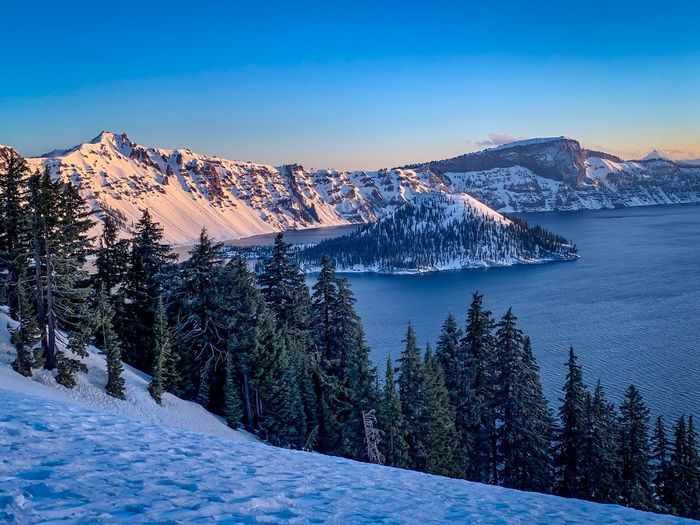 A snow covered Crater Lake Crater Lake National Park Sunrise Mt Mazama Caldera Volcano Crater Lake Snow Winter Cold Temperature Mountain Sky Beauty In Nature Scenics - Nature