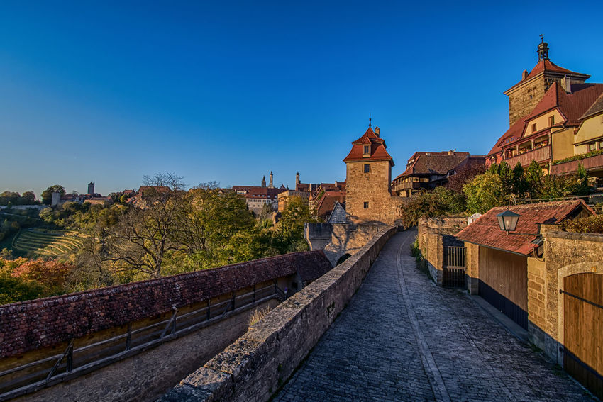 Be nice! The world is a small town. Outdoors Travel Destinations Europe Travelling Architecture Architecture_collection No People TOWNSCAPE Germany Town Rothenburg Ob Der Tauber Bavaria Town Wall Sunset Medival City Medieval Nature_collection Nature City City Life Town Life Town View Blue Sky Autumn Autumn Colors Clear Sky Building Exterior Built Structure