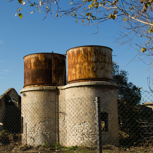 Abandoned Abandoned Places Building Clear Sky Day Low Angle View No People Outdoors Sky Station Steam Steam Train Station Storage Tank Summer Tree Water Tower - Storage Tank EyeEmNewHere