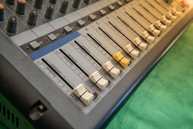 Close up of music mixer equalizer console for mixer control sound device. Sound technician audio mixer equalizer control for background. Industry Music Panel Sound Adjust Arrangement Broadcast Buttons Channels Console Controller Digital Art Equalizer Interface Mixer Professional Sequence Slider Solo Song