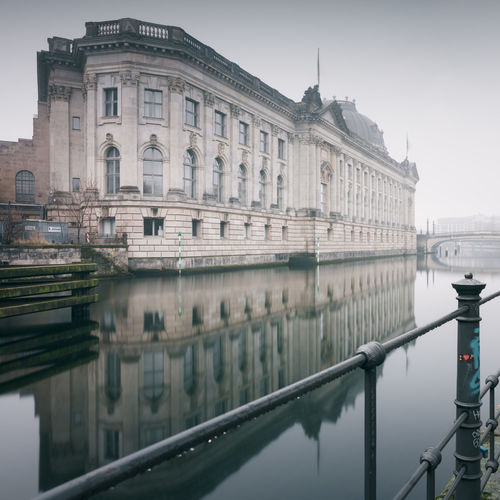 reflection of the bodemuseum berlin in water Architecture Berlin Bodemuseum Building Exterior Built Structure Chain Bridge City Day Fine Art History Long Exposure Muted Colors Nature No People Outdoors Philipp Dase Reflection River Sightseeing Sky Tourism Travel Destinations Water Waterfront Discover Berlin