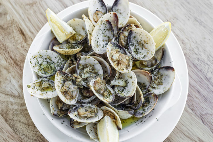 steamed clams Bowl Clams Close-up Day Food Food And Drink Freshness Healthy Eating High Angle View Indoors  Italian Food No People Plate Portuguese Food Ready-to-eat Seafood Serving Size Steamed Clams Table