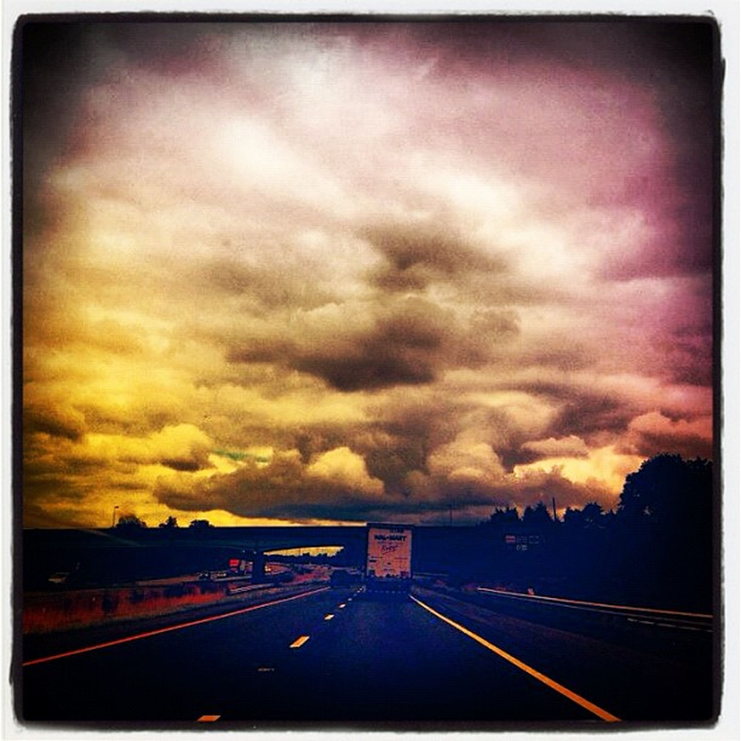 transportation, transfer print, sky, road, the way forward, cloud - sky, road marking, auto post production filter, diminishing perspective, sunset, cloudy, vanishing point, highway, dramatic sky, cloud, overcast, storm cloud, weather, car, nature