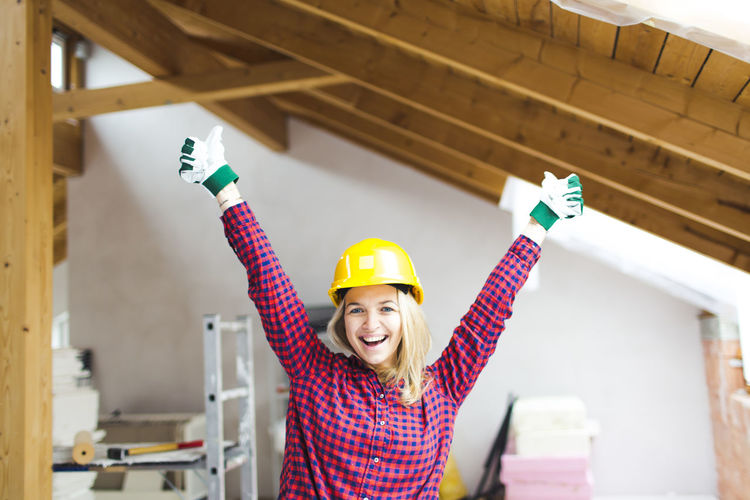 Young woman working at construction site