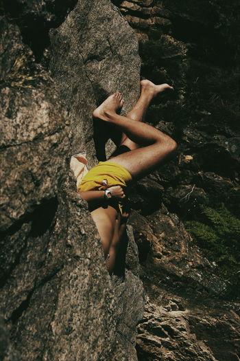 Full Length Of Man Lying On Rock