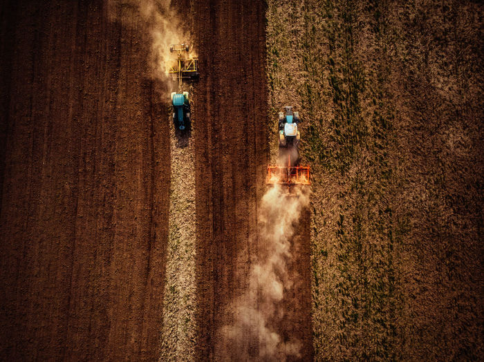 Agriculture Rural Scene Motion Agricultural Machinery Farm Crop  Harvesting Land Field Occupation Cereal Plant Nature Landscape Combine Harvester Plant Machinery Working Environment People Growth Dust Farmer