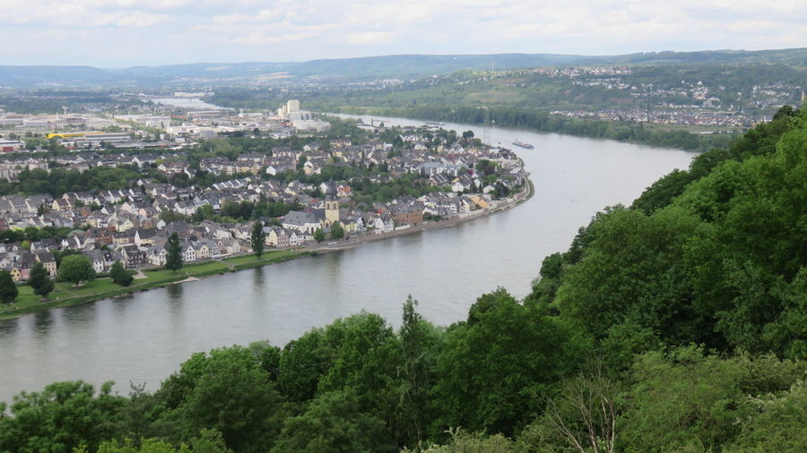 High angle view of rhine river amidst trees and building against sky