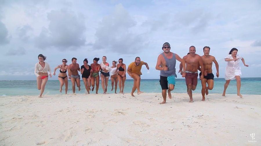 Group of people enjoying on beach