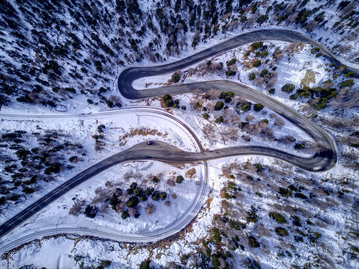 Drone  Aerial Photography Aerial View Beauty In Nature Car Curve Day Dronephotography High Angle View Highway Landscape Mountain Road Nature No People Outdoors Road Snow Street Traffic Transportation Tree Winding Road