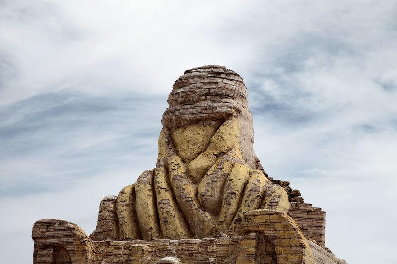 Close-up of weathered sculpture representing dakar rally