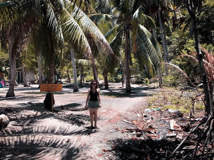 Palm Tree Tree Full Length One Person Nature Adult Adults Only People Tree Trunk Only Women Day One Woman Only Lifestyles Island Islandlife Islandgirl Outdoors Beauty In Nature