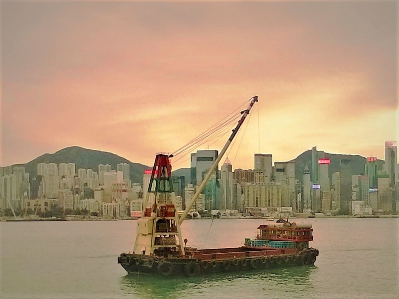 architecture, built structure, building exterior, nautical vessel, waterfront, sea, sky, city, sunset, no people, water, cityscape, outdoors, nature, harbor, urban skyline, day