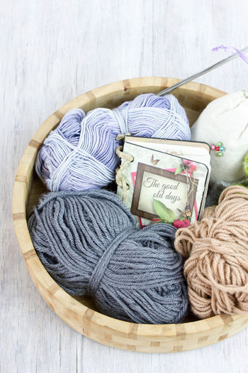 Close up view of diary and wool in wooden container