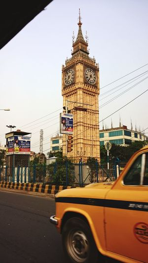 Connected By Travel Travel Travel Destinations Taxi Car Tourism City Yellow Taxi Day Cityscape Clock KolkataStreets Architecture Nostalgic Place