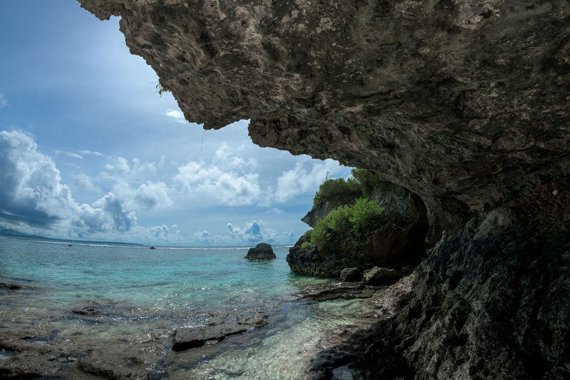 titian Sea Water Rock Sky Rock - Object Solid Beauty In Nature Scenics - Nature Rock Formation Nature Land Day Tranquil Scene Beach Cloud - Sky Tranquility No People Non-urban Scene Horizon Over Water Outdoors Turquoise Colored Eroded