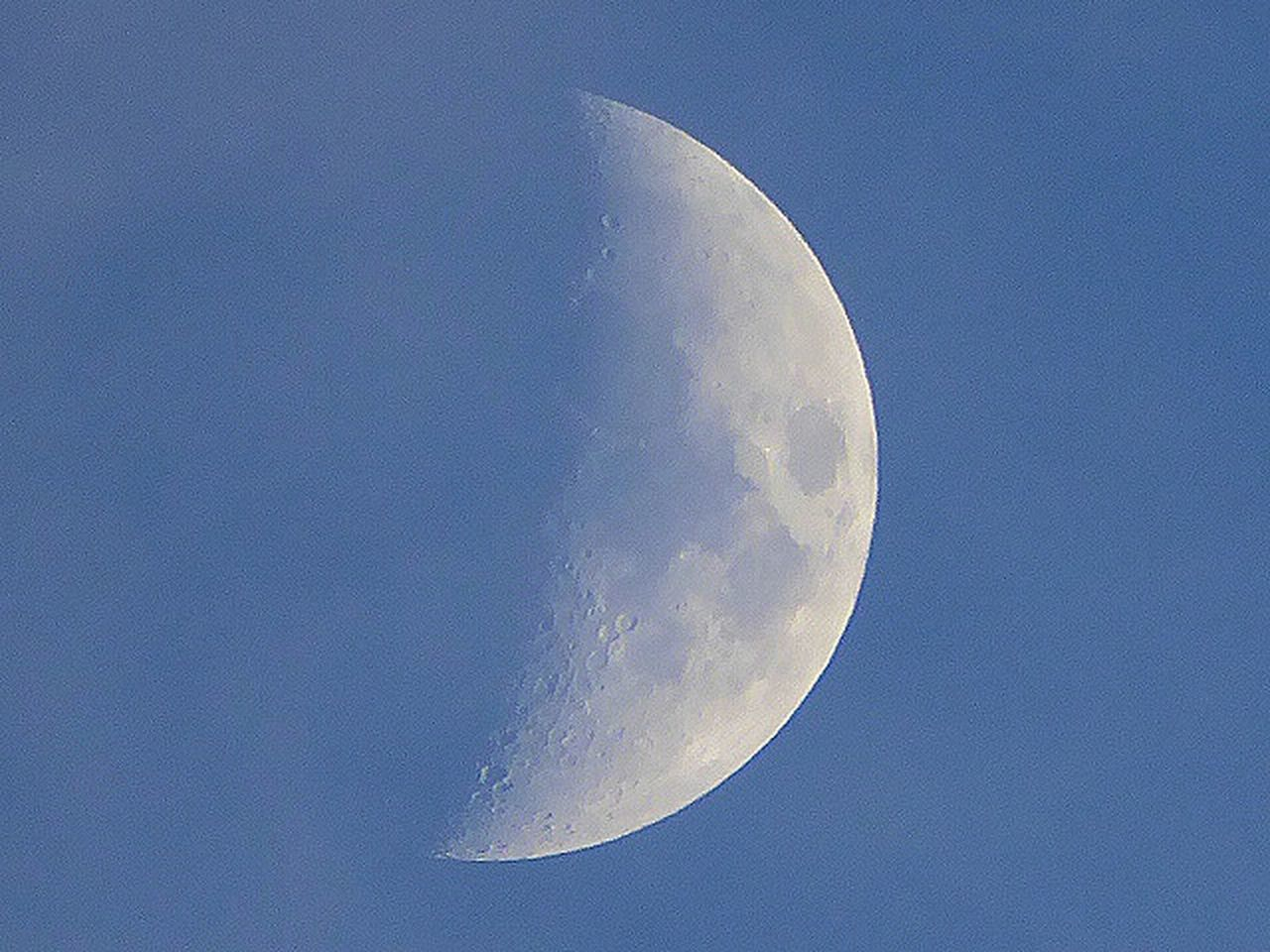 moon, astronomy, beauty in nature, night, nature, moon surface, planetary moon, scenics, majestic, clear sky, tranquil scene, half moon, tranquility, blue, crescent, sky, outdoors, space, low angle view, space exploration, no people, close-up