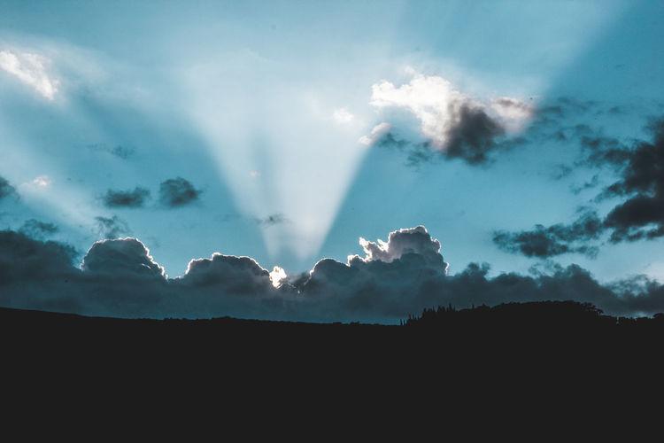 Waipi'o Valley Beauty In Nature Cloud - Sky Dark Dramatic Sky Environment Idyllic Landscape Mountain Nature No People Non-urban Scene Outdoors Scenics - Nature Silhouette Sky Sunbeam Tranquil Scene Tranquility Tree