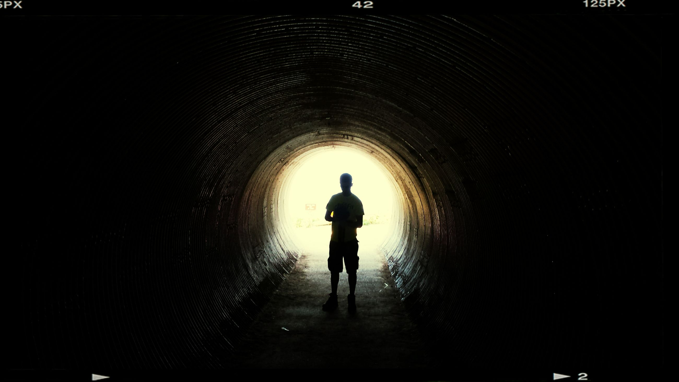 tunnel, indoors, arch, full length, lifestyles, silhouette, walking, men, rear view, light at the end of the tunnel, leisure activity, dark, standing, architecture, built structure, illuminated, archway, the way forward