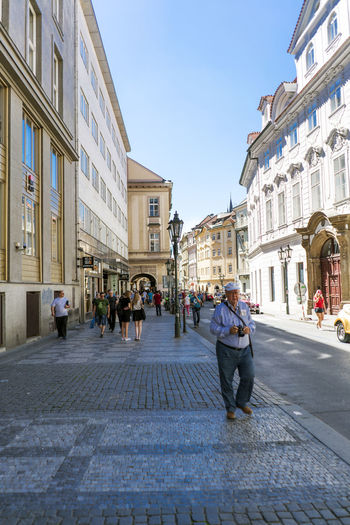 Views of the main monuments and streets of Prague, in the Czech Republic Adult Architecture Building Exterior Built Structure Capital Cities  City Day European  Landscape Lifestyles Medieval Architecture Men Outdoors People Prague Czech Republic Real People Sky Street Stunning Travel Destinations Walking Women