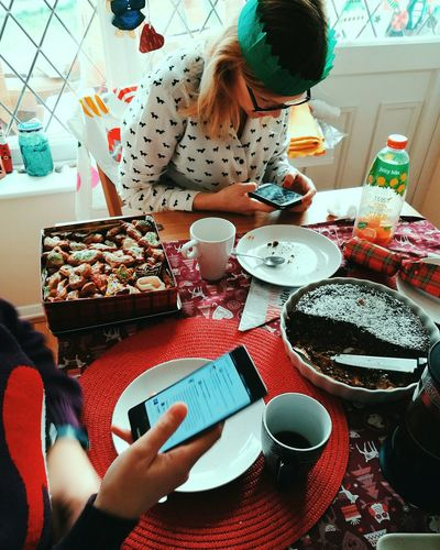 Mobile Conversations Party - Social Event Food And Drink Two People Friendship People Table Indoors  Christmas Celebration Portable Information Device Human Hand Sweet Food Dessert Women Home Interior Food Adult Human Body Part Men Adults Only Mobilephotography Leicaphotography HuaweiP9