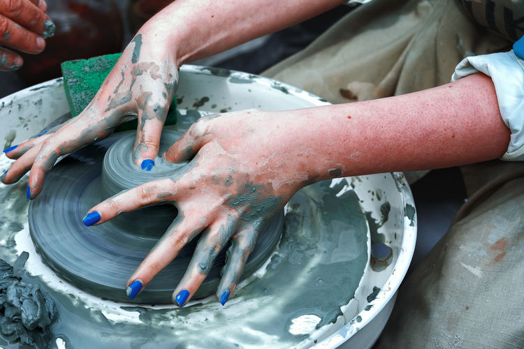 Potter's wheel Cleaning Close-up Day High Angle View Human Body Part Human Hand Indoors  People Real People Water The Week On EyeEm Modern Workplace Culture Clay Pottery Terracotta Ceramics Pot Craft Product Molding A Shape Sculptor Porcelain