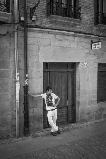 This teenage boy was just waiting for the running of the bulls through this small market town in northern Spain. Trying his best to look cool and casual, despite the nerves and the fact that he wasn't talking to any of the the other boys waiting to run with the bulls. I love the impression he is trying to give. B&w Street Photography Bull Running Casual Outdoors Portrait Puente La Reina SPAIN Street Photography The Street Photographer - 2016 EyeEm Awards Youth