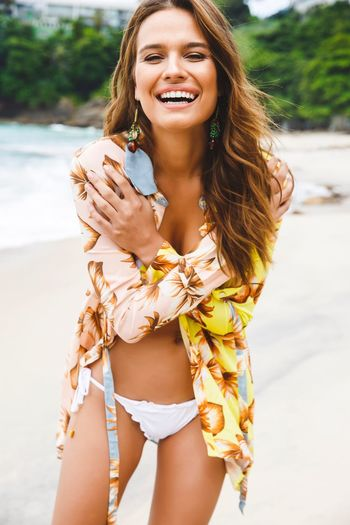 Paint The Town Yellow Real People Lifestyles Outdoors Happiness Beach Rio De Janeiro Brazil Fashion Young Women Smiling Salinas