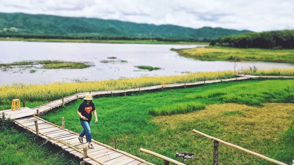Water One Person Landscape Real People Day Beauty In Nature Nature Men Scenics - Nature Tranquil Scene Land Field Lifestyles Tranquility High Angle View Rural Scene Green Color Plant Outdoors