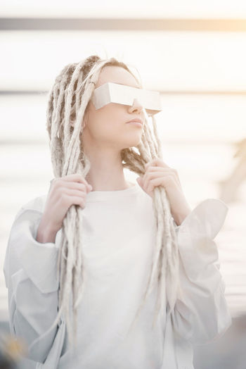Low angle view of hipster with dreadlocks in city