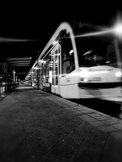 Night Noir Eye4photography  Nopeople Citylife Streetphotography Street Illuminated City Architecture Built Structure Train - Vehicle Moving