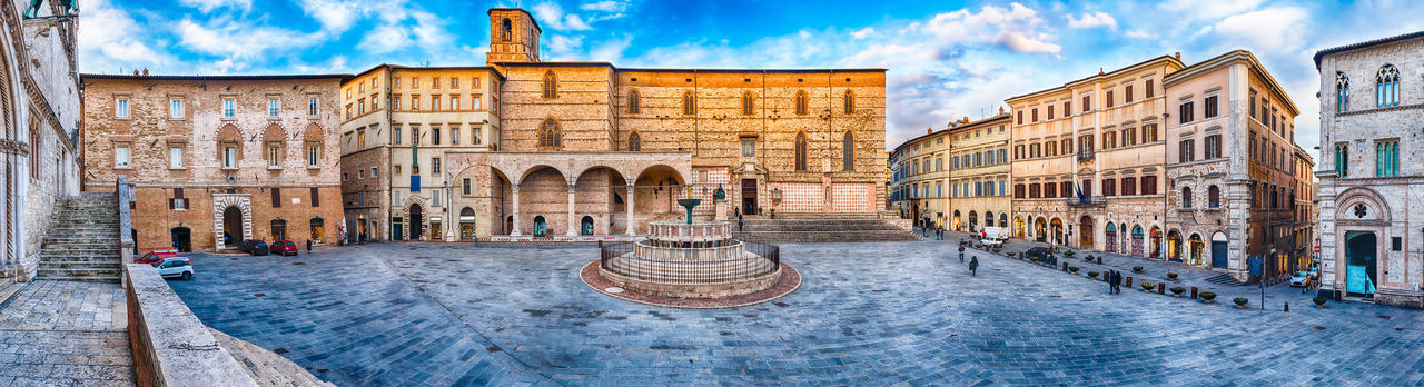 Panoramic view of Piazza IV Novembre, main square and masterpiece of medieval architecture in Perugia, Italy Architecture Built Structure Building Exterior Cloud - Sky Travel Destinations History The Past Tourism City Sky Day Nature Arch Travel Panoramic Building Incidental People Outdoors Architectural Column Ancient Civilization