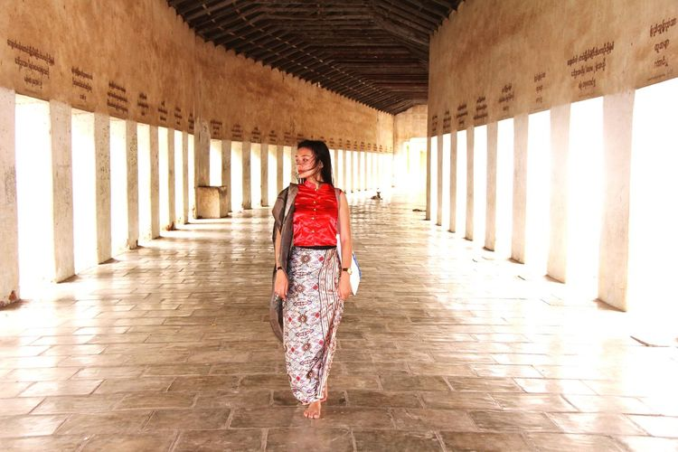 Lady in Red Young Women Beauty Women Smiling Beautiful Woman Beautiful People Females Portrait History Period Costume Architectural Column Visiting Palace Passageway City Gate Neo-classical Historic Traditional Clothing