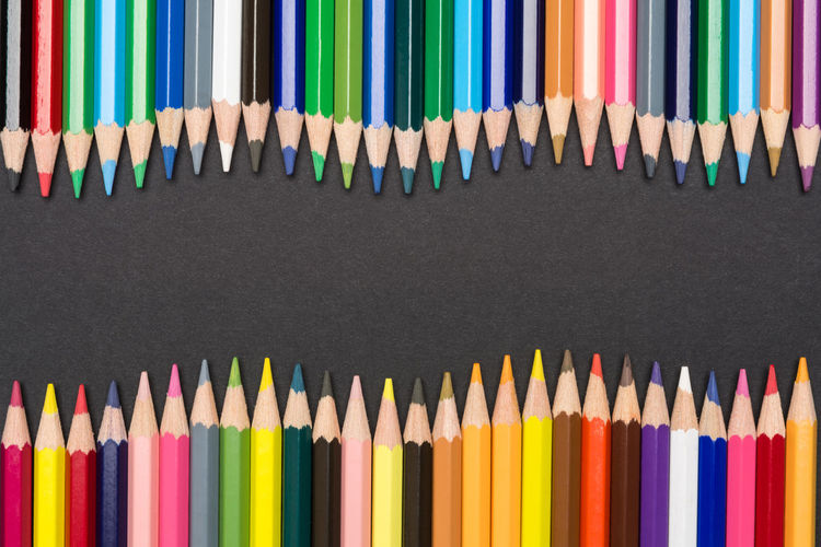Frame of colored pencils in wave shape isolated on black cardboard Black Background Imagination Preschool Shape Sketch Wave Arrangement Art Backgrounds Colored Pencil Colorful Crayon Creativity Draw Education Hobby In A Row Inspiration Multi Colored Pattern Pencil School Variation Vibrant Color Zigzag