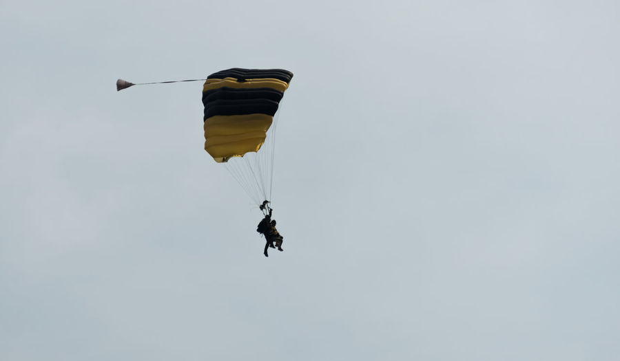 Adventure Day Exhilaration Extreme Sports Flying Freedom Full Length Leisure Activity Lifestyles Low Angle View Mid-air One Person Outdoors Parachute Paragliding People Real People Sky Skydiving Sport Stunt Person