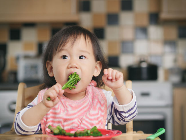 Asian Baby Girl Brocolli Childhood Close-up Cute Day Eating Food Food And Drink Freshness Front View Healthy Eating Indoors  Lifestyles Looking At Camera One Person People Portrait Real People Weaning
