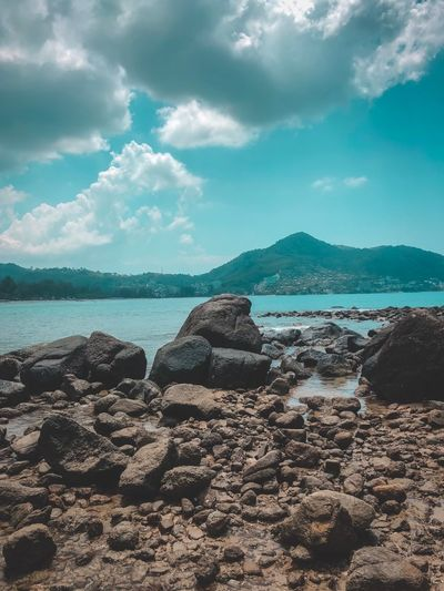 Water Sky Cloud - Sky Sea Beach Beauty In Nature Tranquility Rock - Object No People Solid Idyllic Tranquil Scene Rock Sunlight Land Outdoors Nature Scenics - Nature Day
