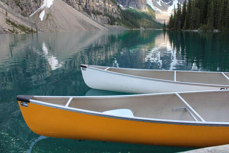 Canoes On Moraine Lake In Winter