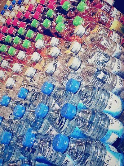 Mineral waters Mineral Water Mineral Wasser GERMANY🇩🇪DEUTSCHERLAND@ Munich Store Display Drinks Water My Capture  Travel Photography Travelgram Shop Around The Corner Shop Corner Colourful Pattern Bottles Of Water Bottles On Deck Bottlecaps Bottle Fine Art Photography