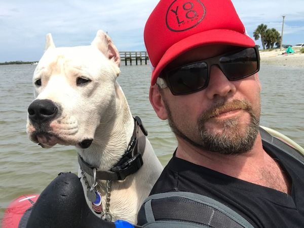 Dog Pets One Person One Animal Animal Themes Beard Domestic Animals Day Real People Outdoors Mammal Water Pet Collar Leisure Activity Lifestyles Portrait Sea Young Adult Nature Close-up Paddleboard NSB Dogo Argentino Tranquility Beauty In Nature Dramatic Sky Pet Portraits Done That.