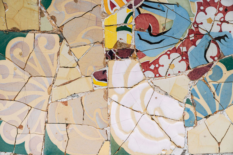 Full frame shot of broken painting on tiled floor