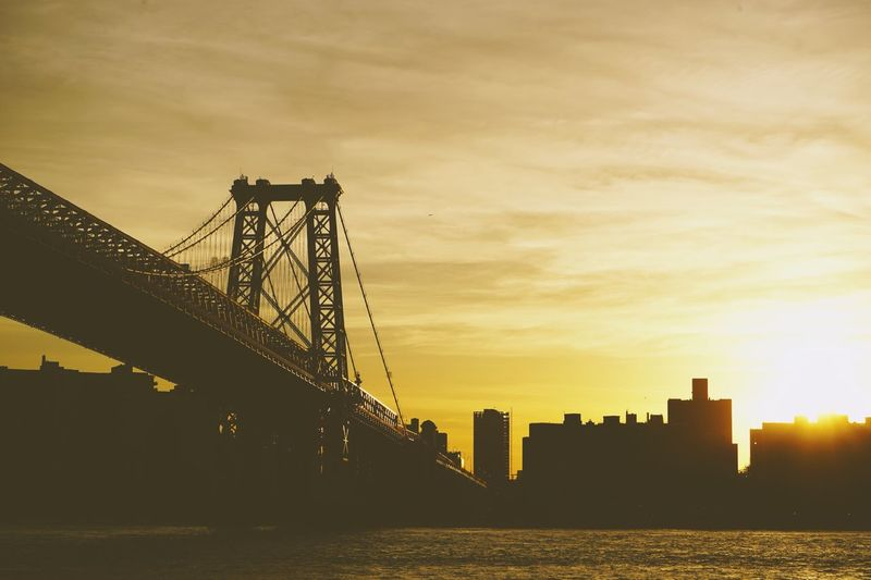 Williamsburg Bridge at Sunset Brooklyn New York Gold Golden Hour Sunset Williamsburg Bridge Bridge Sky Architecture Built Structure Water Machinery Sunset Building Exterior No People Silhouette City Transportation Outdoors