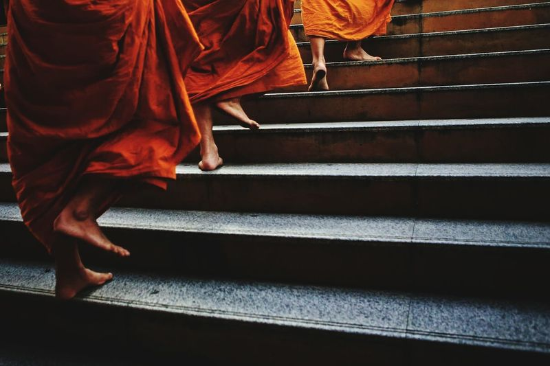 Monks climbing stairs